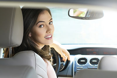 Woman looking back from driver's seat
